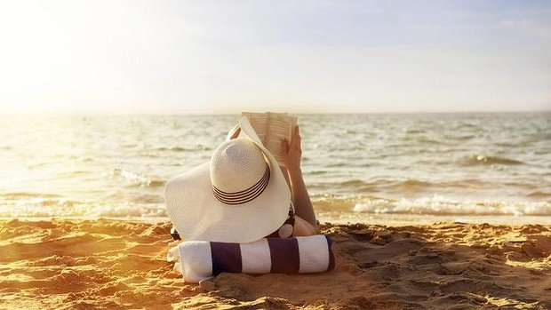 What could be more chilled out - and chilling - this summer than reading crime novels on the beach? Photo: iStock